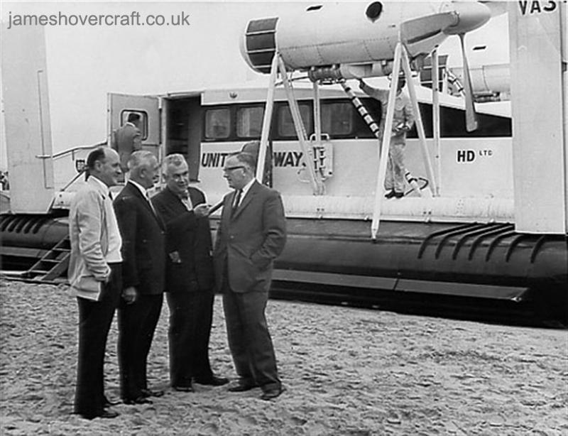First-day certificates and trials of the VA-3 hovercraft - A group of officials including Mr. Harry Parry (in white) greet the crew of VA3-001 upon its arrival at Rhyl in 1962 (Nick Gurney).
