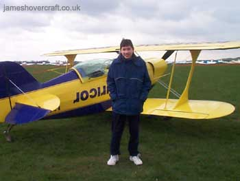 About me - Me next to an aerobatic Pitts airplane, on a trial aerobatics lesson run by Alan Cassidy (competition winning aerobatics pilothttp://www.worldaerobatics.com/) (James Rowson).