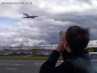 About me - Me taking video of a MD-87 SAS airplane coming into land at Heathrow Airport, 2001 (James Rowson).