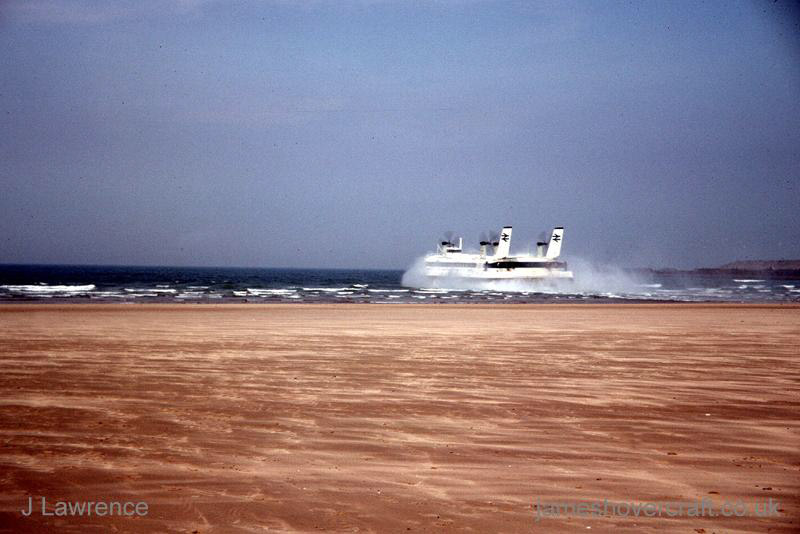 The SRN4 with Seaspeed in Calais - Departing Calais hoverport (Pat Lawrence).