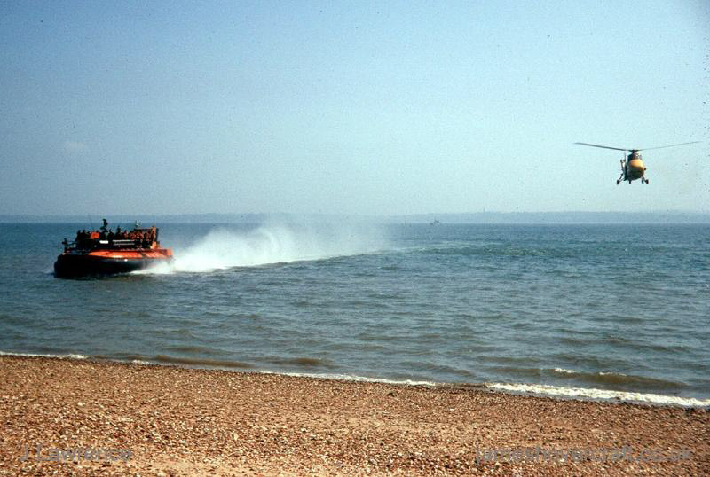 The SRN5 - Approaching shore, with helicopter escort (Pat Lawrence).