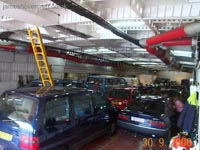 SRN4 systems tour - Looking aft from the port forward car deck access door. Note the cars all pointing aft, and the cockpit ladder locked in the down position. Further along in the shot on the far wall notice a change in height of the car deck roof into what appears to be an alcove. This is the area originally designated extra passenger space in the Mk I version of the SRN4, and is also the area where the 19m extension of the two Super-4 craft was inserted during their expansion in the '80s.  (James Rowson).